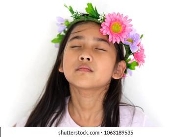 Portrait Asian Thailand kids little girl close eyes wear Flower crown