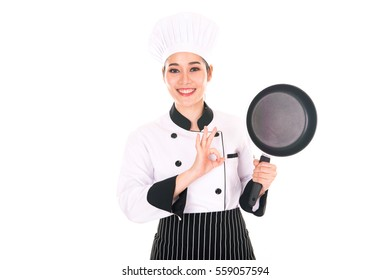 Portrait of asian woman chef holding a pan