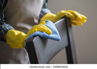 portrait of asian woman cleaning service staff cleaning dining table in dining room
