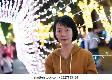 portrait of Asian woman face at night