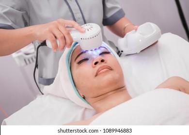 portrait asian woman getting treatment of collagen mask. rf skin tightening machine