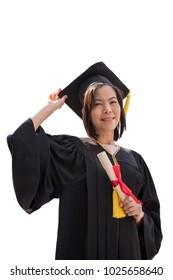 Portrait of Asian woman with graduation cap and gown holding diploma isolated on white background.