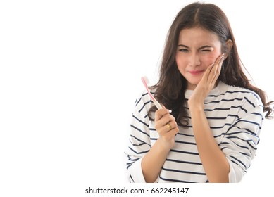 Portrait  of asian woman have a toothache holding toothbrush isolated on white background.This image for  woman toothache concept.