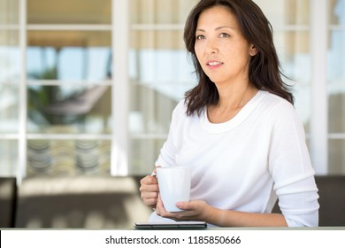 Portrait of an Asian woman having coffee.