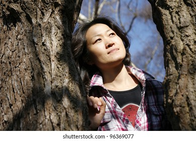 Portrait asian woman, looking off into distance