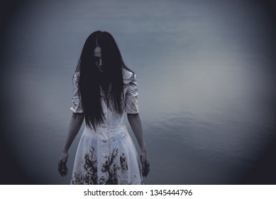 Portrait of asian woman make up ghost face at the swamp,Horror scene,Scary background,Halloween poster,Thailand people