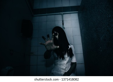 Portrait of asian woman make up ghost face with blood,Horror scene,Scary background,Halloween poster,Thailand people