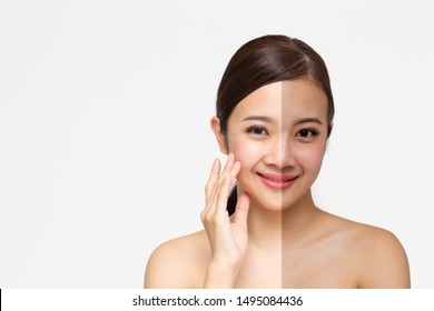 Portrait of Asian woman with perfect healthy glow skin face and white and tan face skin isolated on white background. Beauty clinic of skincare and skin medical spa cosmetics concept