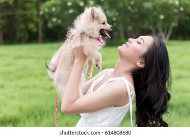 portrait of Asian woman playing dog
