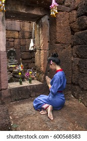 portrait of asian woman praying in old public temple