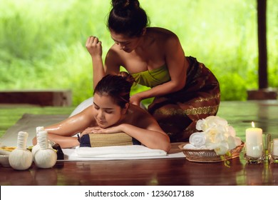 Portrait of Asian woman is relaxing in spa massage, Thai massage.