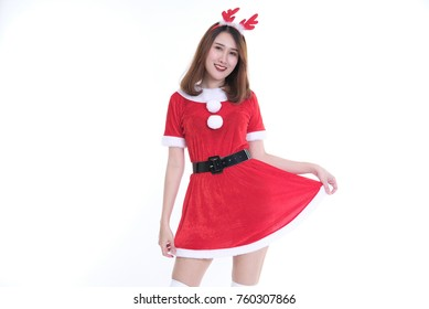 portrait of asian woman in santa claus dress on white background. christmas holiday. merry xmas celebration. season's greetings