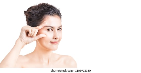 Portrait of asian woman skincare makeup isolated on white background, asian beautiful girl with pretty smile her fingers touch her eyes. Surgery eyelid beauty technology spa treatment concept banner
