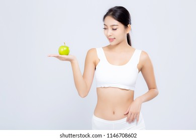 Portrait asian woman smiling holding green apple fruit and beautiful body diet with fit isolated on white background, model girl weight slim with cellulite or calories, health and wellness concept.