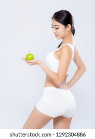 Portrait asian woman smiling holding green apple fruit and beautiful body diet with fit isolated on white background, girl weight slim with cellulite or calories, health and wellness concept.