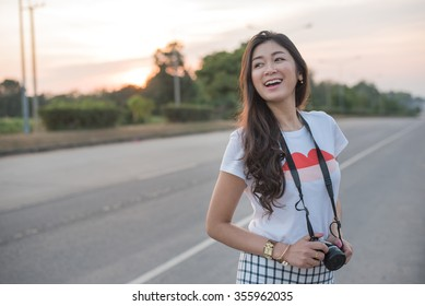 Portrait of Asian woman traveler photography hipster lifestyle on the road with camera