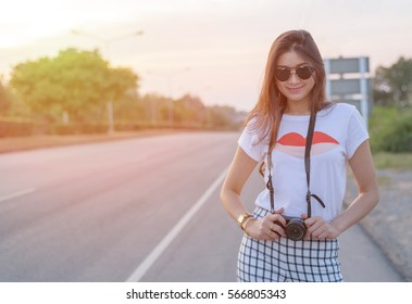 Portrait of Asian woman traveler photography hipster lifestyle stay on the road with camera