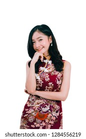 Portrait of Asian woman wearing chinese dress,cheongsam,qipao present and show something on copy space white isolated background and smile