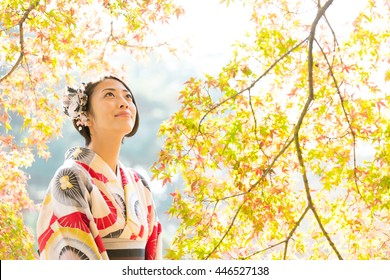 portrait of asian woman wearing japanese traditional kimono in autumn