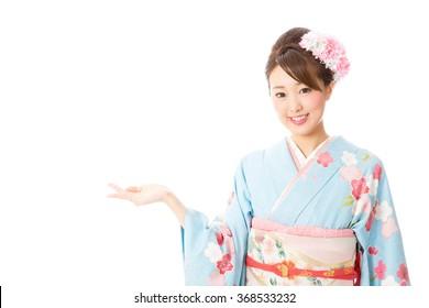 portrait of asian woman wearing kimono isolated on white background