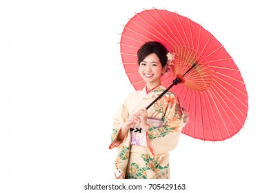 portrait of asian woman wearing kimono holding traditional red umbrella isolated on white background