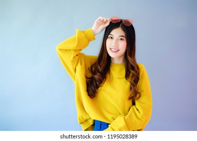portrait asian woman wearing long sleeve clothes on background with fashion sunglass, Winter fashion set