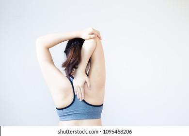 Portrait of Asian women age between 25-30 years old doing a stretching before exercise close up haft body.