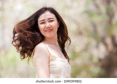 Portrait of the Asian women close up half body on nature bokeh background.