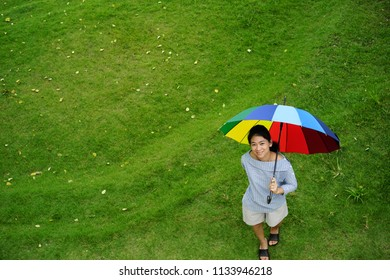Portrait Asian women hold rainbow umbrella
