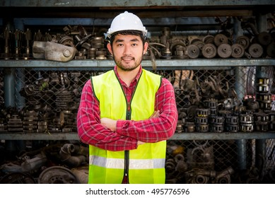 Portrait of Asian worker in Factory warehouse car parts.