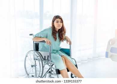 Portrait of Asian worrying patient on wheelchair in hospital. She worry sick about medical expense and her injury. The sick patient need moral support for physical therapy. Insurance concept.