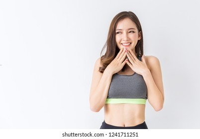 Portrait of Asian young beautiful athletic sexy woman showing biceps, asian woman workout  at the gym sport club, Cute Korean girl exercise healthcare and medical authentic lifestyle concept