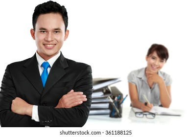 A portrait of asian young businessperson as a team leader. his secretary at the background