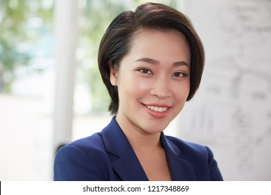 Portrait of Asian young businesswoman smiling at camera