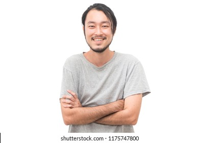 Portrait of a asian young handsome man with arms crossed and smiling while standing isiolated on white background