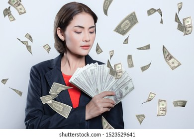 Portrait of asian young woman holding a dollar bill. Business woman show the money in hand. Isolated background white.