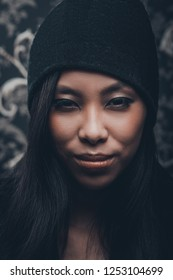 Portrait of asian young woman in wool cap
