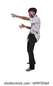 Portrait of asian zombie man with wounded hand standing isolated over white background
