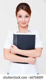 portrait of assured businesswoman with black folder over grey background