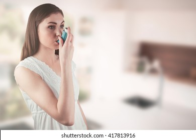 Portrait of an asthmatic woman against empty modern kitchen