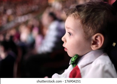 Portrait of astonished boy at a circus