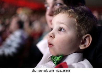Portrait of astonished child at a circus