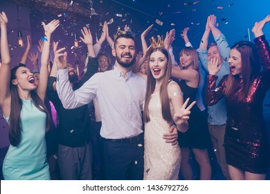 Portrait of astonished people screaming lovers become king queen holiday hug embrace wear dress formal wear suit disco discotheque