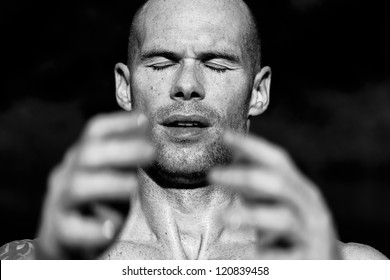 Portrait of an athlete raising his hands in concentration, or at the finish