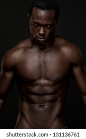 Portrait of an athletic african american man topless