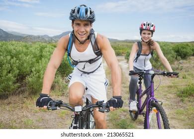 Portrait of an athletic couple mountain biking