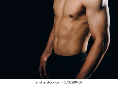 portrait of athletic muscular bodybuilder man with naked torso six pack abs. fitness workout concept