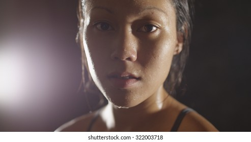 Portrait of athletic woman sweating taking a break from workout