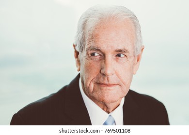 Portrait of attentive businessman looking away