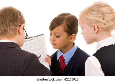 Portrait of attentive girl looking at boy signing papers